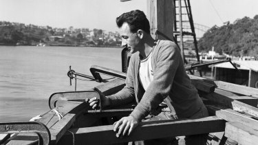 Boat builder Reg Holmes, pictured at Lavender Bay on 20 September 1956, building a boat to take guests crocodile hunting in the Gulf.