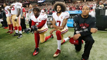 Then-San Francisco 49ers quarterback Colin Kaepernick (7) and outside linebacker Eli Harold (58) kneel during the playing of the national anthem before an NFL football game against the Atlanta Falcons in Atlanta in December, 2016.