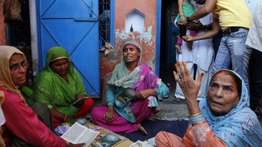 Relatives mourn the killing of Mohammad Akhlaq at his home in India.