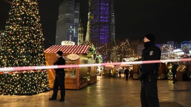 Police guard a Christmas market in Berlin, after a truck ploughed into the crowd.