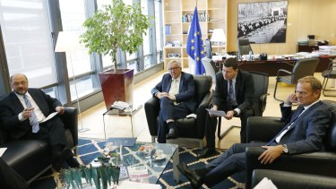 European Parliament president Martin Schultz, Mr Juncker and (far right) European Council president Donald Tusk meet in Brussels on the morning after the Brexit vote.
