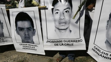 Relatives of the missing students carry their photographs at a march in Iguala in south-west Mexico on Monday.