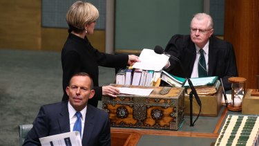Foreign Affairs Minister Julie Bishop pictured on June 4 tabling a letter after adding to an answer on Man Haron Monis writing to Attorney-General Senator George Brandis.