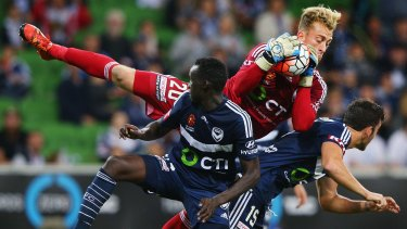 Backing up: Victory goalkeeper Lawrence Thomas makes a save in the round-27 clash.
