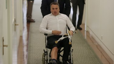 Take a knee: From January 1 injuries to MPs may be eligible for compensation if a parliamentary scheme passes. Former cities minister Jamie Briggs, who sustained his injury after a friendly tackle on Tony Abbott last year won't qualify.