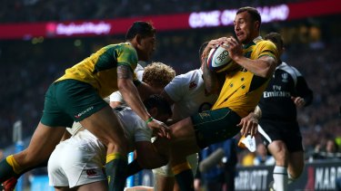 Quade Cooper is smashed in tackle.