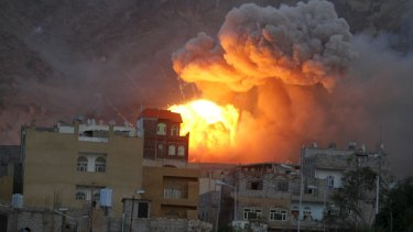 Fire and smoke billows from an army weapons depot after it was hit by an air strike in Yemen's capital Sanaa on Monday.