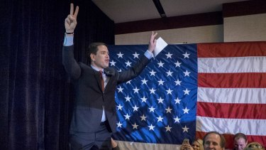 Marco Rubio acknowledges the crowd after addressing supporters at a caucus night party in Des Moines, Iowa, on Monday.