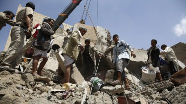 People search for survivors amid the rubble of houses destroyed by Saudi-led airstrike in Sanaa, Yemen on Monday.