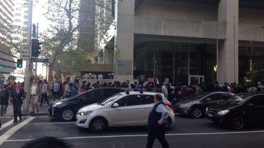 Apple customers on York Street, Sydney at 7.50am.