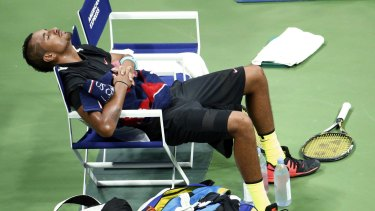 Seeking clarity: Nick Kyrgios takes a break between sets at the US Open..