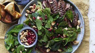 Lamb, spinach and date salad with crisp pita.