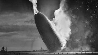 The German dirigible Hindenburg crashes to the ground, tail first, in flaming ruins after exploding on May 6, 1937.