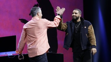 Canadian rapper Drake high-fives Eddy Cue, Apple senior vice-president of Internet Software and Services, at the Apple Music launch.