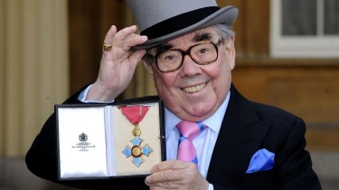 Comedian Ronnie Corbett after he received his Commander of the British Empire at Buckingham Palace.