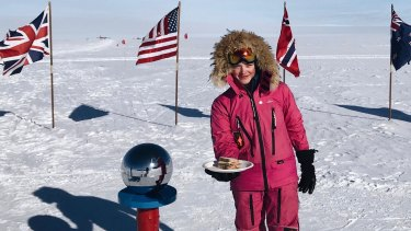 Teenage adventurer Jade Hameister at the South Pole with the sandwich she made to respond to her online trolls.