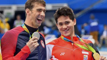 Medal tally: Phelps with Schooling after the 100 metres butterfly final.