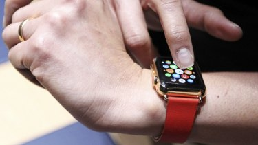 An attendee tries out an Apple Watch folowing the event.