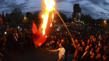Demonstrators set fire to a Turkish flag during a torch-bearing march marking the anniversary of the 1915 mass killings of Armenians in the Ottoman Empire, in the capital of Armenia, Yerevan, on April 23 last year.