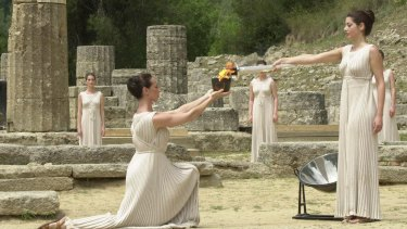 The ancient traditions were brought back to life at the opening ceremony of the Athens Olympics in 2000. The torch was lit at Olympia's temple of Hera, on the site where the original Olympics were born in 776 BC.