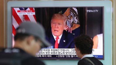 A local news program broadcasts Donald Trump's remarks at the Seoul Train Station in Seoul, South Korea.