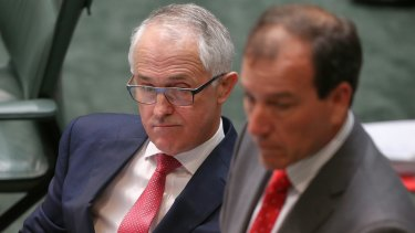 Prime Minister Malcolm Turnbull and former frontbencher Mal Brough during Question Time at Parliament House in early December.