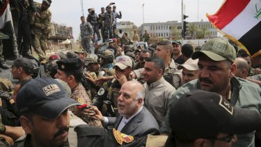 Iraq's Prime Minister Haidar al-Abadi Tikrit after Iraqi security forces regained control from Islamic State militants.