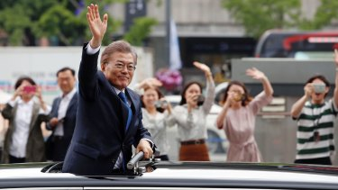 South Korea's President Moon Jae-in greets supporters after his inauguration ceremony in Seoul.