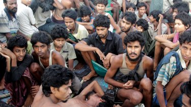 Migrants sit on the deck of their boat as they wait to be rescued by Acehnese fishermen in Indonesia this week.