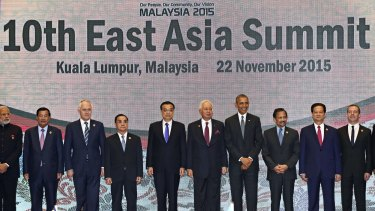 U.S. President Barack Obama and other leaders participate in the East Asia Summit family photo in Kuala Lumpur, Malaysia, Sunday, Nov. 22, 2015. Obama is in Malaysia where he joins leaders from Southeast Asia to discuss trade and economic issues, and terrorism and disputes over the South China Sea. Other leaders are from left: India's Prime Minister Narendra Modi, Cambodia's Prime Minister Hun Sen, Australia's Prime Minister Malcolm Turnbull, Laos' Prime Minister Thongsing Thammavong, Chinese Premier Li Keqiang, Malaysia's Prime Minister Najib Razak, Obama, Brunei's Sultan Hassanal Bolkiah, Vietnam's Prime Minister Nguyen Tan Dung, and Russia's Prime Minister Dmitry Medvedev.  (AP Photo/Susan Walsh)