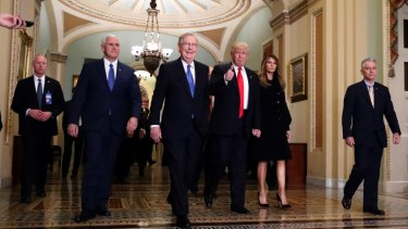 New era: Vice President-elect Mike Pence, Senate Majority Leader Mitch McConnell, President-elect Donald Trump and his wife Melania at Capitol Hill on Friday.