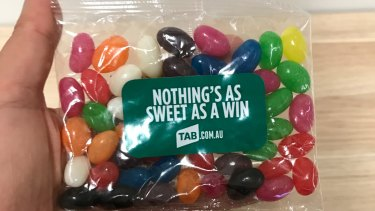 Not so sweet: A TAB-branded packet of jelly beans, which was handed out to Greens MP Justin Field.