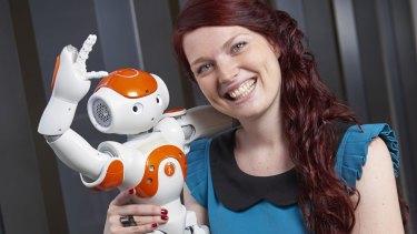 Deanna Hood with a Nao robot.