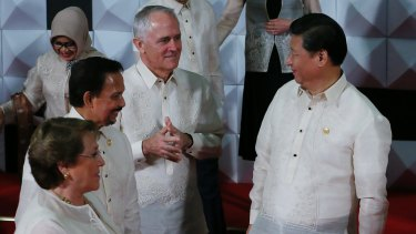 Chinese President Xi Jinping, right, talks with Prime Minister Malcolm Turnbull  at the 2015 APEC summit in Manila.