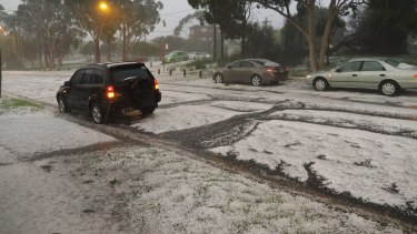 Cars are pelted with hail in Kingsford.