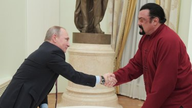 American actor Steven Seagal got his passport personally from Russian President Vladimir Putin.