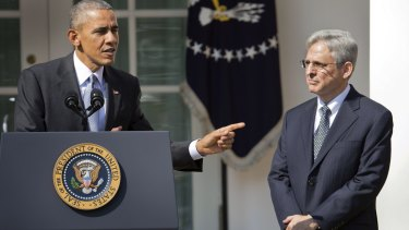 He's my guy: Barack Obama points to Merrick Garland, the man he will nominate to the US Supreme Court.