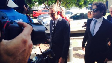 LEGAL ISSUES: Gold Coast Titans player Beau Falloon arrives with his lawyer at Southport Magistrates Court.