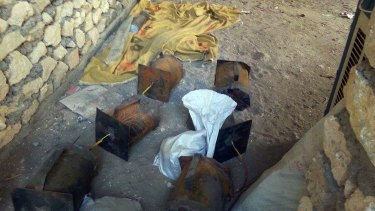 Unexploded bombs left behind by IS militants near al-Houz bridge on the Euphrates river west of Baghdad.