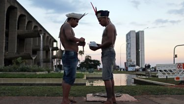 Indigenous tribe members attend a demonstration against Rousseff's impeachment in Brasilia on Wednesday.