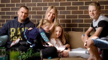 Erica Mitchell and her family are considering moving out of Canberra to a regional town as they struggle to cost with rising living expenses. L-R: Josh and Erica Mitchell with their children Sofia, 2, Aria, 6, and Phoenix, 9.
