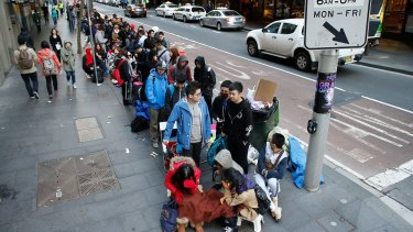 People queue for an iPhone in Sydney last year. Imagine giving the last person a phone first.