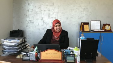 Aesha Abu Shaqfa works at the Future Development Commission, one of many local NGOs seeking to further women's rights in a male-dominated society.