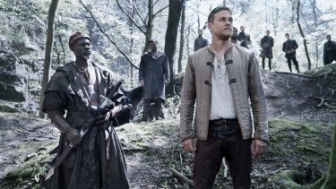 Charlie Hunnam as king-to-be Arthur (right) with Neil Maskell as Back Lack in <i>King Arthur: Legend of the Sword</i>.