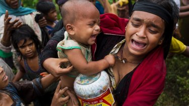 A Rohingya woman after a fight erupted during food distribution at a refugee camp in Kutupalong, Bangladesh