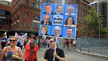 Protesters march against the Abbott Government and its policies at Town Hall and George Street on Sunday in Sydney, Australia.