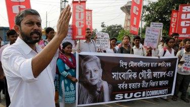 Activists march at a demonstration against Lankesh's killing in Kolkata.