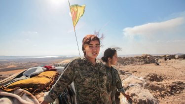Women fighters from the Kurdish YPG militia. Turkey's concerns about Kurdish military strength have hindered the formation of a coalition to check Islamic State.