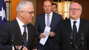 George Brandis with Peter Dutton, centre, and Malcolm Turnbull  announcing the new Home Affairs ministry in July.
