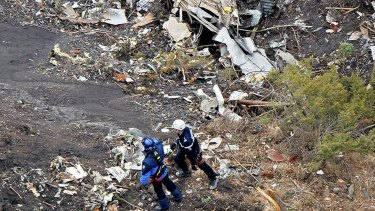 French investigators sift through wreckage at the crash site.